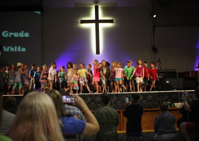 kids singing on stage